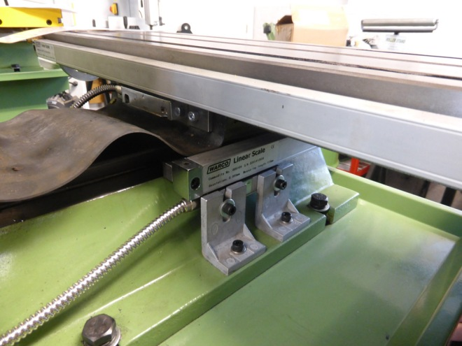 Cross traverse viewed from the back of milling machine.